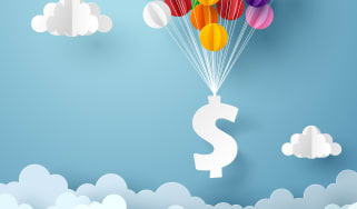 A dollar sign attached to balloons floats against a sky with clouds