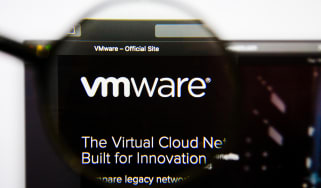 The VMware website as seen through a magnifying glass against a monitor