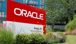 A sign with Oracle's logo on it outside some offices