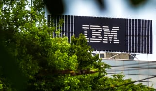 An IBM sign visible through trees