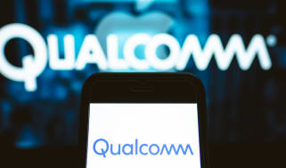 Qualcomm logo displayed on a smartphone screen