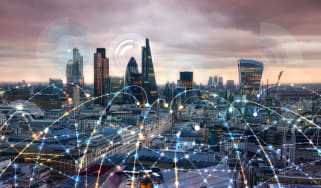 Image of London skyline with lines representing network traffic