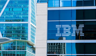 A glass building with the IBM logo displayed on the window