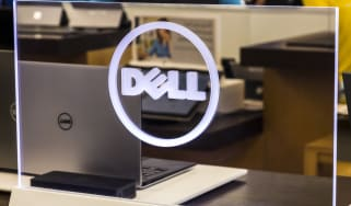 Dell laptop logo displayed in front of Dell laptops