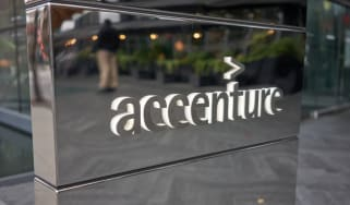 The Accenture sign on a mirrored block