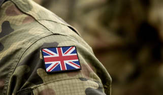 A close up of a Union flag on the shoulder of a soldier's uniform