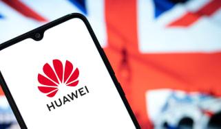 Smartphone displaying Huawei logo, UK flag in background