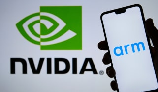 The Arm logo on a smartphone in front of the Nvidia logo in the background