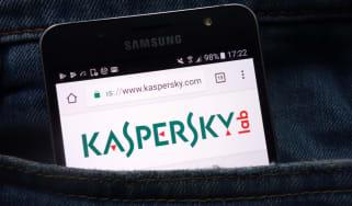 The Kaspersky website on a smartphone in a pocket