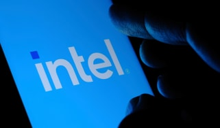 The Intel logo displayed on a smartphone being held