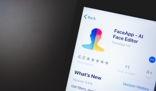 A smartphone showing the download screen for FaceApp, an AI face-swapper