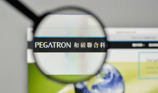 The logo of Pegatron placed under a magnifying glass