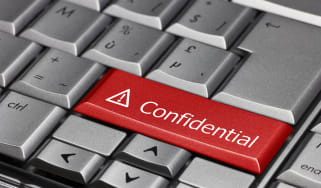 """A grey keyboard with one red button displaying the word """"confidential"""""""