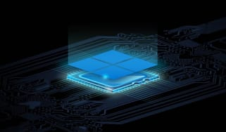 Abstract image of the Microsoft logo ontop of a glowing processor