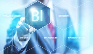 Businessman pointing to Business Intelligence icon
