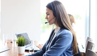 A woman working as a call centre agent