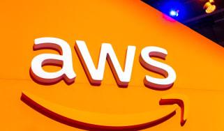 The AWS logo over an orange board