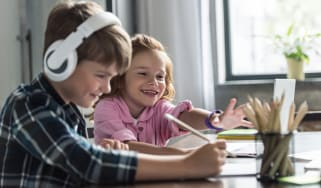 Kids learning at home via a laptop