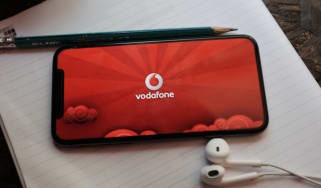 A smartphone on a notepad with Vodafone data