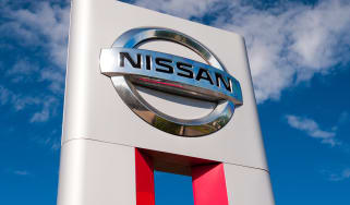 Nissan sign on a background of the sky