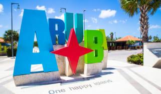 Colorful Aruba sign near the beach