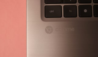 Dell's Latitude Chromebook with a close up of the 'Chrome' logo