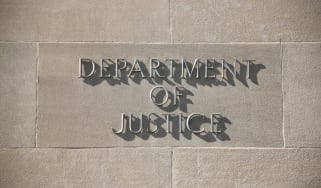 Department of justice sign on a building