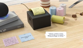 An Amazon sticky note printer on a desk