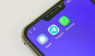 Smartphone displaying Signal, Telegram and WhatsApp applications