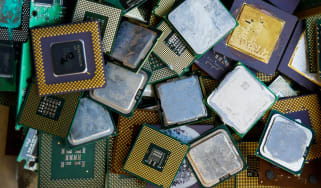 A pile of discarded processors sorted on a bin in a recycling and recovery compound