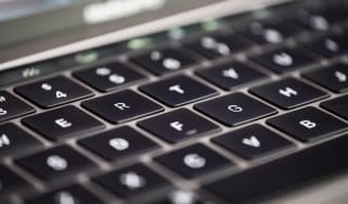 A close-up shot of a MacBook keyboard