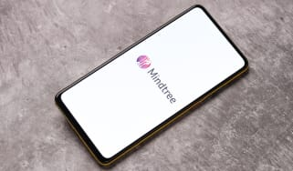 The Mindtree logo on a smartphone