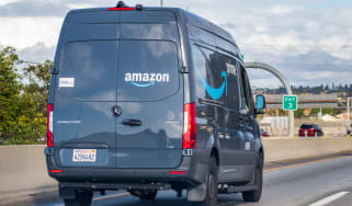 Amazon van driving down the highway