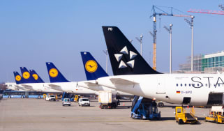 The tails of various passenger aircrafts including Star Alliance and Lufthansa planes