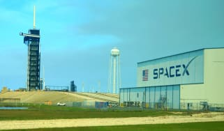 SpaceX building with a launch pad behind it