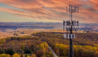 Telecommunications mast in a rural part of the UK at dusk