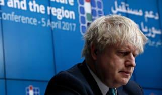 The prime minister Boris Johnson looking downward