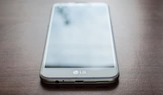 An LG smartphone on a desk