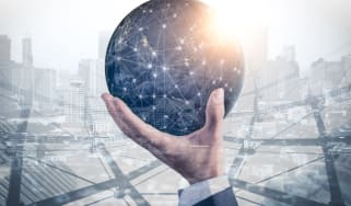 man holding digital globe