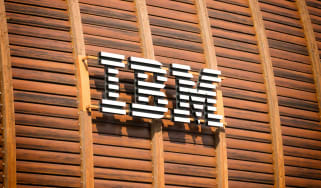 IBM's logo on the outside of a wood-panelled building