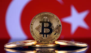 The physical embodiment of Bitcoin behind a Turkish flag
