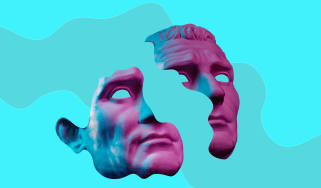 A sculpture of a man's face carved in two on a blue background