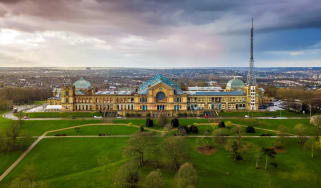 An aerial view of the front aspect of Alexandra Palace, with roof antenna visible