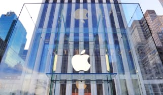 Apple logo on a glass entrace to a skyscraper