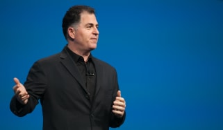 Dell Technologies CEO Michael Dell giving a keynote speech in front of a blue background