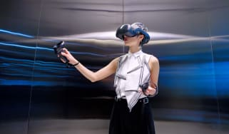 The HTC Vive Focus 3 being used by a woman in an office