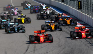 A pack of Formula 1 racing cars competing at the 2019 Russian Grand Prix in Sochi