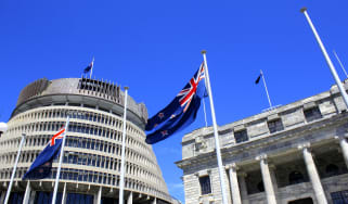 The New Zealand flag flying outside of Parliament