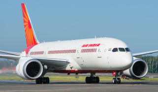 An image of one of Air India's planes on the runway