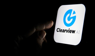 A finger about to press the Clearview AI App